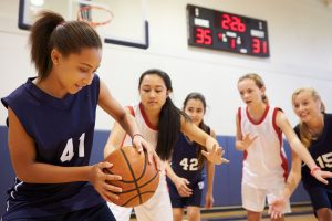 33478120 - female high school basketball team playing game