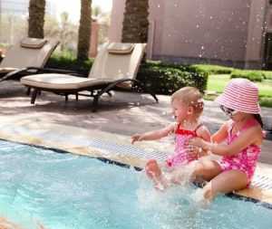 Kids playing by pool